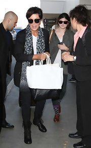 Kris Jenner topped off her dark airport outfit with this white oversized tote bag.