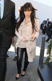 Kim Kardashian kept it simple and chic with a nude coat and matching top.