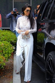 Kourtney Kardashian went to church on Easter rocking a white lace bodysuit by Misha Collection.