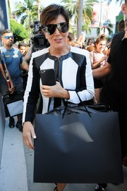 Kris Jenner went shopping in Beverly Hills looking sporty in her shield sunglasses.