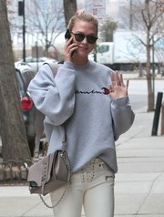 Karlie Kloss took a stroll in New York City carrying a gray Versace Stardvst bag.