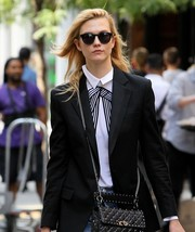 Karlie Kloss ran errands in New York City wearing a pair of Sunday Somewhere Soelae sunglasses.