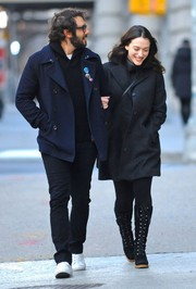 Kat Dennings bundled up in a dark gray wool coat for a stroll in New York City.