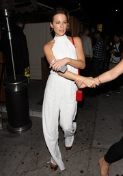 Kate Beckinsale looked effortlessly stylish in a white halterneck jumpsuit by Alexis while leaving the Nice Guy.