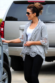Kate Beckinsale paired a basic pair of black leggings with a cool grey cardigan.