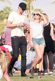 Alexander Skarsgard, perfects the casual look in a plain black baseball cap ideal for shielding himself from the sun at Coachella.