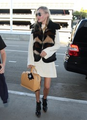 Kate Bosworth styled her simple frock with a multicolored fur vest.