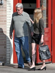 Kate Bosworth looked street-chic in a black-and-white grid-print blouse teamed with leather shorts while having lunch with her dad.