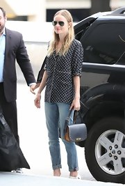 Kate Bosworth chose a patterned button down for her travel look while out in LA.