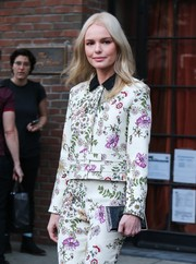 Kate Bosworth stepped out in New York City sporting a black box clutch and floral suit combo.