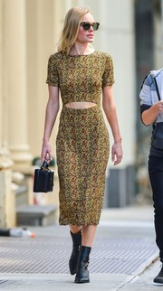 Kate Bosworth looked summer-ready in a print dress with a midriff cutout while out and about in New York City.