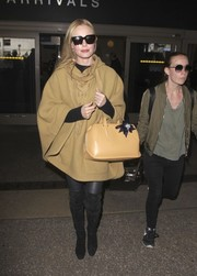 Kate Bosworth was classic and chic in a beige lace-up cape by Chloe while arriving on a flight at LAX.