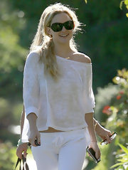 Kate looks cool and casual in her white burnout, off-the-shoulder Bali sweatshirt.