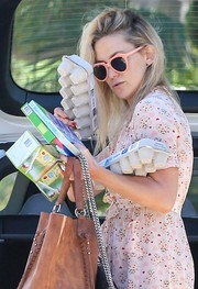Kate Hudson wore a cute pair of angular peach shades by Karen Walker while attending an Easter party.