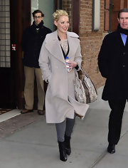 Katherine Heigl accented her posh coat with a neutral snakeskin tote.