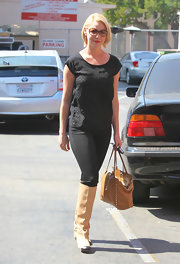 Katherine Heigl added contrast to her all black style with cream knee high boots.