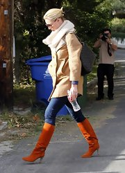 Katherine Heigl bundled up for fall in a wool coat paired with burnt orange knee-high boots.