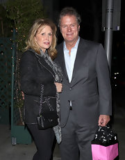 Kathy Hilton wore a classic black tweed jacket for a dinner out with her husband.