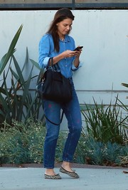 Katie Holmes donned a casual denim shirt for a day out in LA.