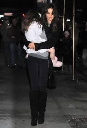 Katie Holmes paired a monochromatic look with black suede boots. The slouchy boots gave her casual look polish.