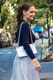 Katie Holmes flaunted a chic silver Chanel bag while shopping in New York City.