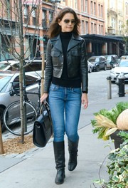 Katie Holmes took a stroll in New York City carrying a black leather tote, which matched her jacket and boots.