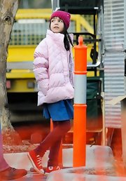 Bailee Madison was spotted on set wearing a pink puffer jacket.