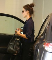 Katie Holmes headed out in LA carrying a stylish black leather tote.
