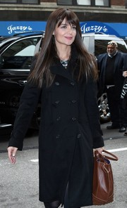 Katie Holmes was spotted out in New York City carrying a stylish studded tote by Tod's.