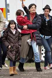 Black Ugg boots and a North Face jacket keep Katie Holmes warm.