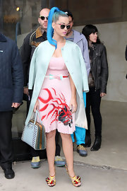 Katy Perry was sweet as candy in a pale blue satin coat and pleated pink dress.