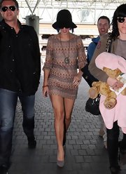 Katy Perry accessorized her mini dress with gray suede platform pumps.
