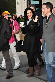 Katy looks very cozy in her studded trench coat and brown, sheepskin boots.