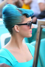 Katy Perry promoted her eyelash collection with Eylure wearing her bright blue tresses in a French twist with rolled bangs.