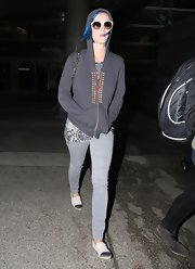 Katy Perry kept a low-profile at LAX in gray skinny jeans and a studded hoodie.
