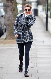 Kelly Brook opted for a sporty look in pink-detailed running shoes.