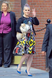 Kelly Osbourne paired her skirt with a long-sleeve graphic tee.