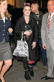 Kelly Osbourne bundled up in a simple black wool coat for a visit to 'Seth Meyers.'