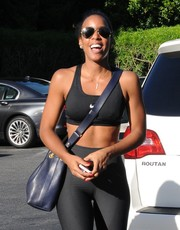 Kelly Rowland styled her workout look with a chic purple crossbody bag for a day out in LA.