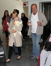 Kelsey Grammer looked cozy in his taupe cardigan as he arrived on a flight at LAX.
