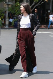 Kendall Jenner rocked high-waisted red corduroys while shopping at Fred Segal.