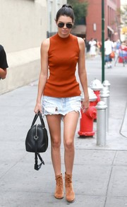 Kendall Jenner completed her strolling ensemble with tan suede lace-up boots by Gianvito Rossi.