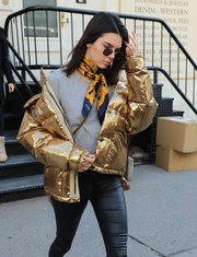 Kendall Jenner spiced up her shopping outfit with a printed scarf by Chanel.