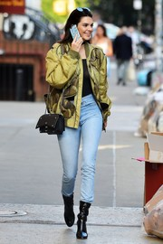 a64a02eeeb77 Kendall Jenner styled her look with a chic black chain-strap bag, also by