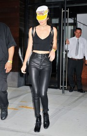 Kendall Jenner teamed her sexy crop-top with black leather skinnies by Unravel.