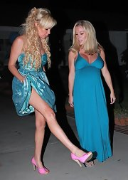 Bridget showed off her cute pink peep-toe pumps to her preggers gal pal Kendra. These bubble gum colored heels completed her party themed ensemble.