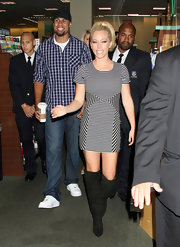 Kendra Wilkinson was casual chic at a book signing in LA. The reality starlet donned a striped mini dress paired with knee-high black boots.