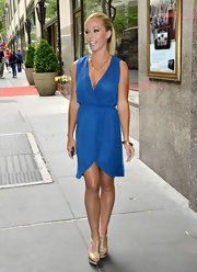 Kendra Wilkinson looked simply chic in her faux-wrap day dress out in NYC.