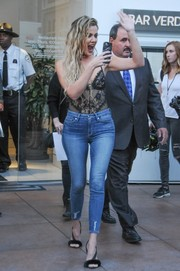 Khloe Kardashian pulled her attention-grabbing look together with a pair of black fur slingbacks by Olgana Paris.