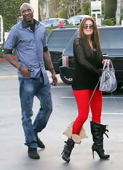Khloe Kardashian was spotted filming her new reality show in black knee high Aviator boots lined with shearling.